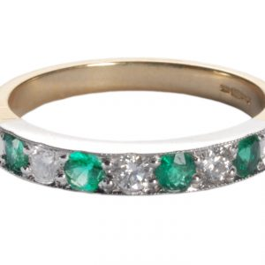 image of diamond and emerald ring.